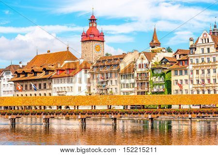 View on the riverside with city hall and old wooden bridge in Lucerne old town in Switzerland
