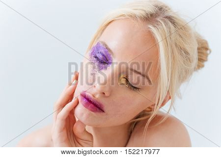 Beauty portrait of sensual girl with fashion makeup over white background
