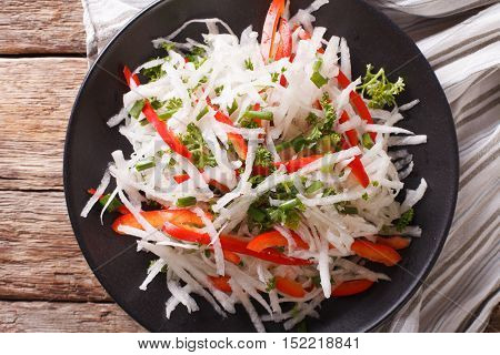 Tasty Salad Of Daikon With Pepper And Herbs Closeup On A Plate. Horizontal Top View