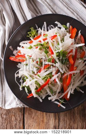 Healthy Food: Salad Of Daikon With Pepper And Herbs Closeup. Vertical Top View