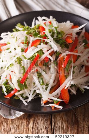 Diet Food: Salad Of Daikon With Pepper And Herbs Closeup. Vertical