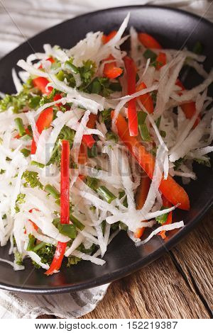 Fresh Salad Of Daikon With Pepper And Herbs Closeup. Vertical