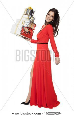 Charming Woman Holding Many Gifts. Happy New Year. Marry Christmas. Isolated On White.