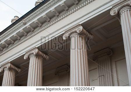 tall white columns of the building facade.