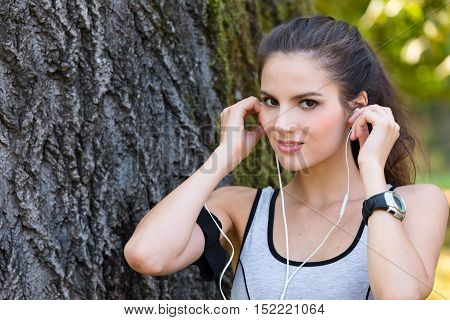 Smiling Woman Wearing Earphones And Getting Ready For Running