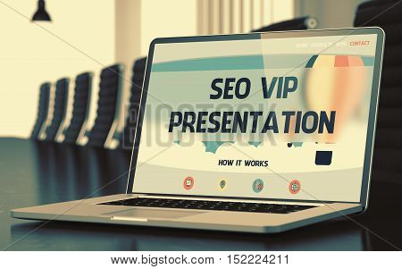 Laptop Display with SEO VIP Presentation Concept on Landing Page. Closeup View. Modern Conference Hall Background. Toned Image. Blurred Background. 3D.