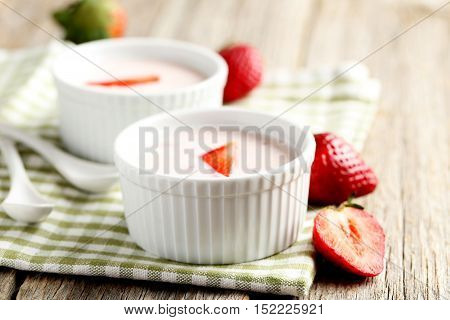 Strawberry Yogurt In Bowl On A Grey Wooden Table