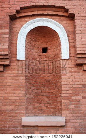 architectural niche in the brick Old Red wall.