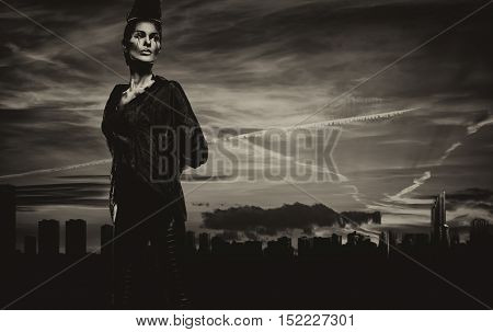 Woman with a creative chess figures make-up against Benidorm skyline. Spain. Black and white image