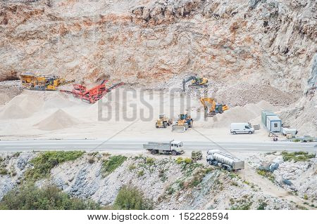 Group of machines working at gravel pit