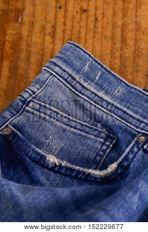 Close up of blue jeans ,Blue Jeans texture on wooden floor