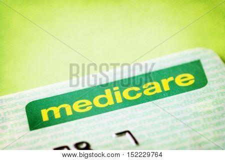 Australian Medicare card over textured background.