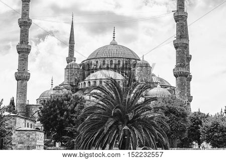 Sultan Ahmed Blue Mosque in Istanbul Turkey - one of the most popular landmarks in the city. Close view during the day with cloudy sky. Black and white