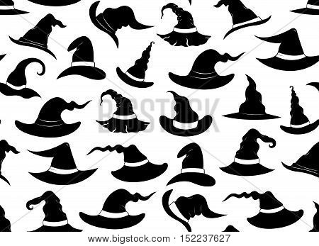 Seamless background of witch hats isolated on white