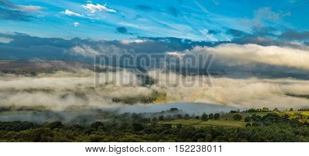 Morning Mist and Dramatic Sky over British Countryside
