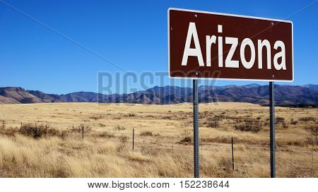 Arizona road sign with blue sky and wilderness