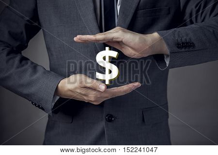 3D Us Dollar Sign In Between Two Hands Of Businessman