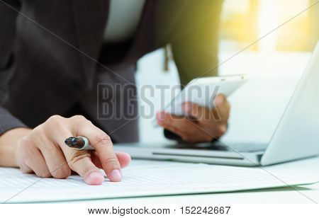 businesswoman holding mobile phone about research data on internet for discuss business planning market and target market at meeting room,business content,business background.