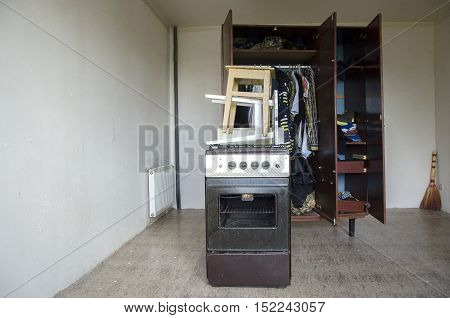 Room with stools, old gas stove and closet