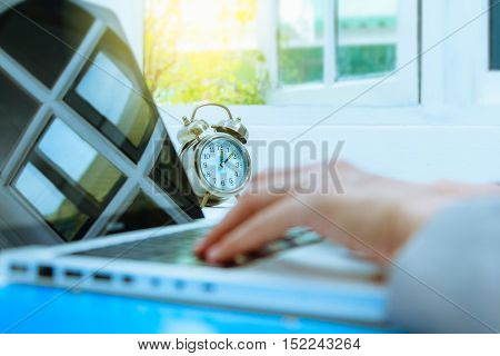 Business people write something about meeting subject on laptop computer, business content and business background.