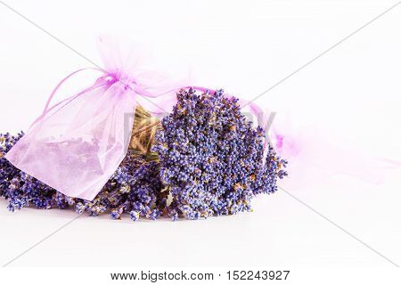 Making aroma bags, bunch of dry wild mountain lavender flowers and wooden bowl