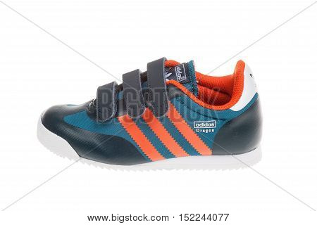Varna Bulgaria - APRIL 16 2016 :ADIDAS ORIGINALS DRAGON children shoe. Isolated on white. Product shot. Adidas is a German corporation that designs and manufactures sports shoes clothing and accessories