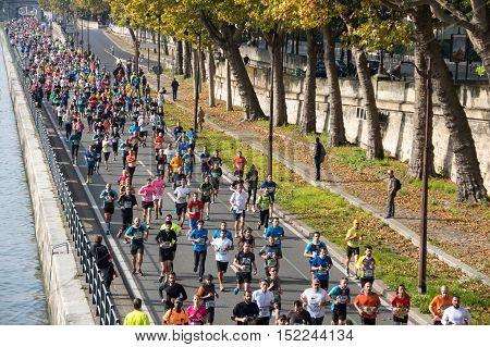 PARIS FRANCE - OCTOBER 11 2015: People running marathon in historical center of Paris France