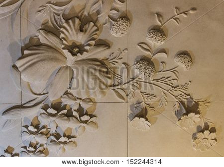 Flowers carved sandstone on the walls. background