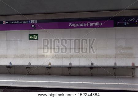 Barcelona, Spain - 24 September 2016: Barcelona metro platform Sagrada Familia. Empty metro platform with sign Sagrada Familia in Barcelona Catalonia, Spain.