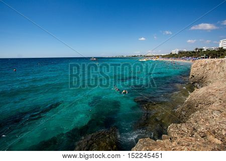Stone cliff in a beautiful blue sea Cyprus photo for you