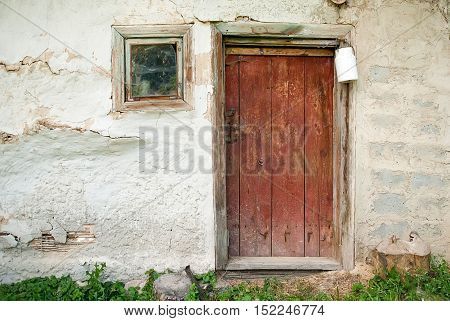 Rustic wooden barn door with white milk can background