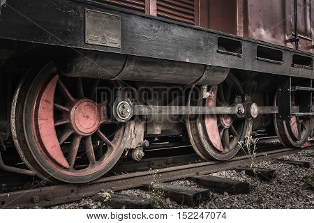 Closeup view of the driving wheels from an old locomotive