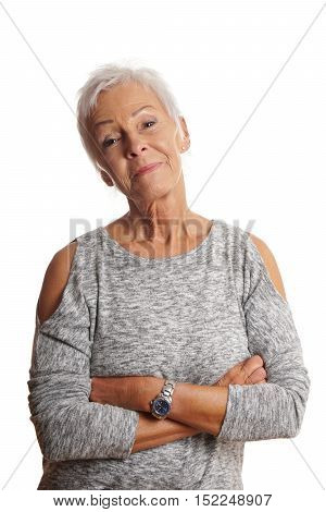 confident mature woman with arms folded and head tilted. isolated on white.