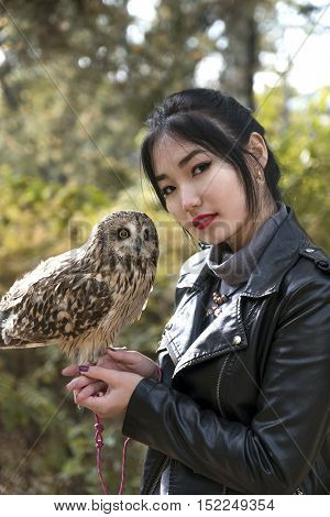 Asian Girl With An Owl In The Street