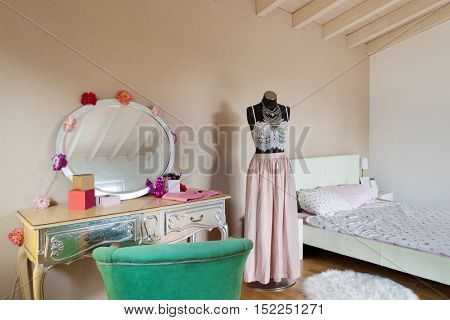 Wide bedroom of a teenager in a loft