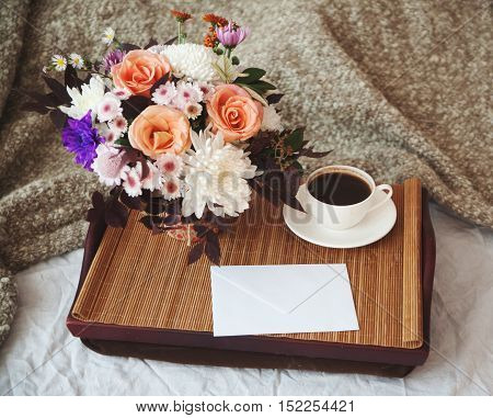 A Bouquet Of Flowers On A Tray