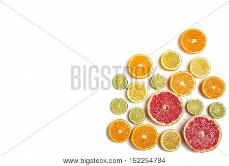 Sliced citrus isolated on white. Cut lemon, orange, grapefruit and lime. Fresh juicy citrus
