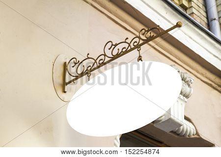 Signboard shop. Mock up. Oval shape. Vintage style display outdoor