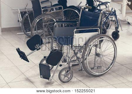 Empty wheelchair parked in hospital. Empty wheelchair
