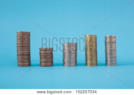 Stack of coins on blue soft background