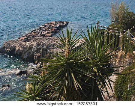 A beautiful view of the Kalamaki bay with crystal turquoise sea water near Kassiopi town. North Corfu. Greece.