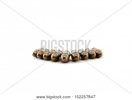 11mm bullets for a short gun. bullets isolated on white background.