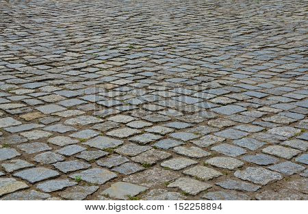 Paving stone perspective surface. Old cobblestone road