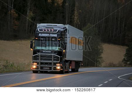 SALO, FINLAND - OCTOBER 16, 2016: Black Scania temperature controlled truck of Element Trans on highway in the evening.