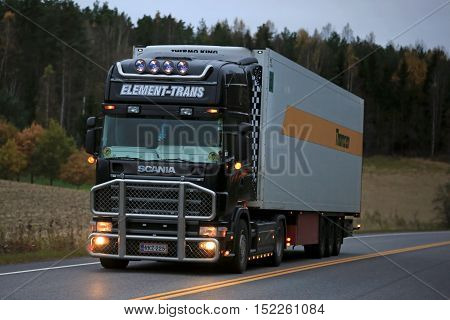 SALO FINLAND - OCTOBER 16 2016: Black Scania temperature controlled truck of Element Trans on highway in the evening. Refrigerated trucks can haul a variety of goods that require a climate-controlled handling.