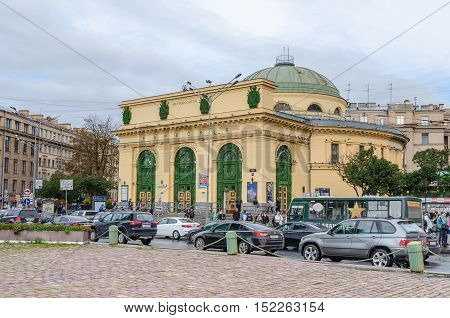 Saint Petersburg Russia - September 30 2016: Narvskaya subway station in the Narva Square (known as Stachek Square or Square of the Strikes) with its irregular-shaped neoclassical pavilion and a dome at one end band an afternoon rush hour traffic.