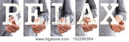 man Hands holding letter text relax word