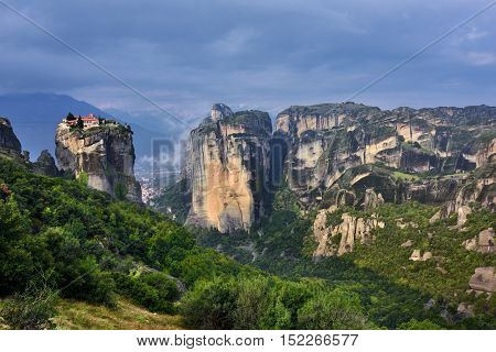 Meteora monasteries. Beautiful view on Monastery of the Holy Trinity placed on the edge of high rock at sun rises Kastraki Greece