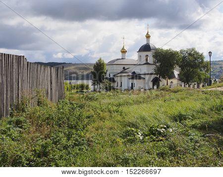 the Orthodox Church fence green grass streetlight
