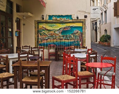 Rethymno,Crete,Greece-August 9,2016 g:cafe on the street of Rethymno in August 09,2016 g,in Rethymno,Crete.Walk down the street with cozy cafes,Rethymno,Crete.